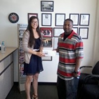 Omni's Jacksonville, NC office: Customer Andre, pictured with Customer Care Specialist Bethany Sharpe.