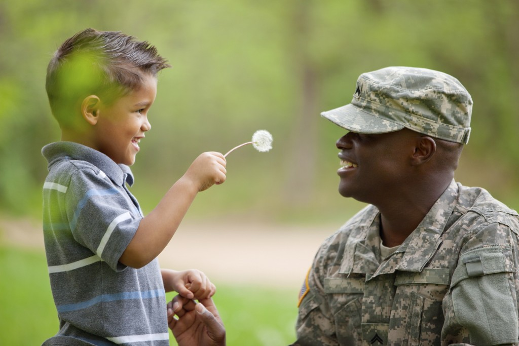 child looking at solider