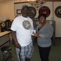 Omni Financial Fayetteville, NC: Customer James Ford, with Fayetteville Customer Care Specialists Erica Wright