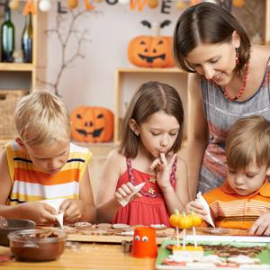 Military family making Halloween treats and crafts