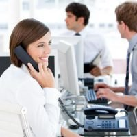 Customer assistance worker on an office phone call