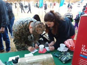 Fort Lee Military Family signing up for Omni Raffle at Booth Current Alt Text   Omni Military Loans