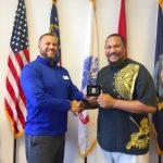 Omni Financial Augusta, GA: Customer Liatama Mauga with General Manager Luis Cruz