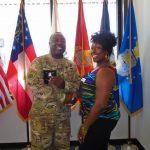 Omni Financial Hinesville, GA: Customer SFC Jaime Ruffin with Customer Care Specialist Kyoko Fripp