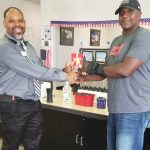 Omni Financial Hinesville, GA: Customer SFC Scott with General Manager Adrian Parker